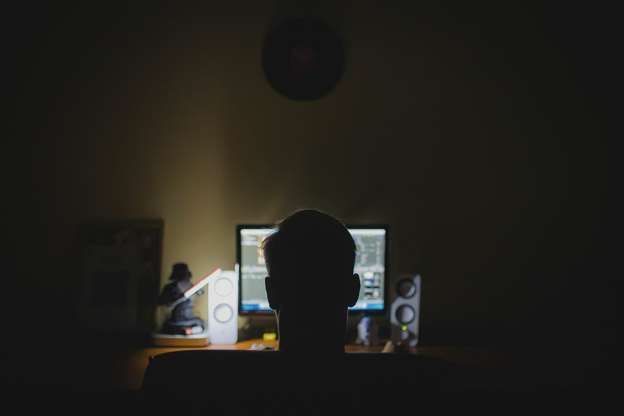 Man doing research on computer at night