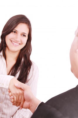 lady shaking hand after excelling in exploratory interview