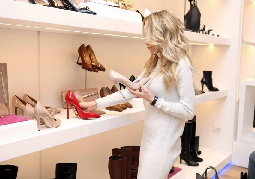 beautiful woman selecting footwear